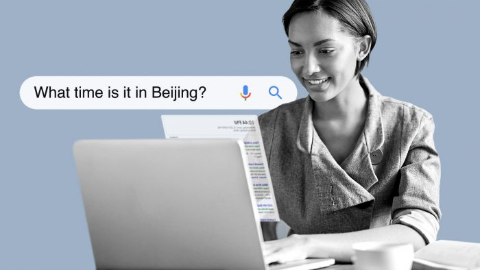 "Person searching on a laptop for ""what time is it in Beijing?"""